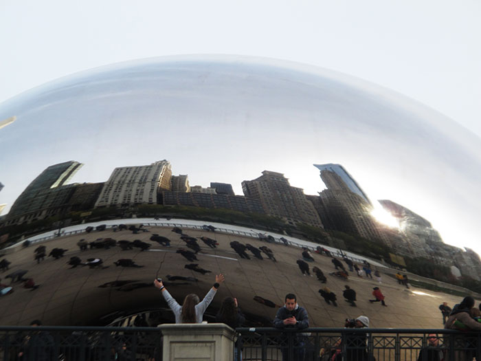 Pedestrians around Cloud Gate see themselves and the skyline in one amazing view.
