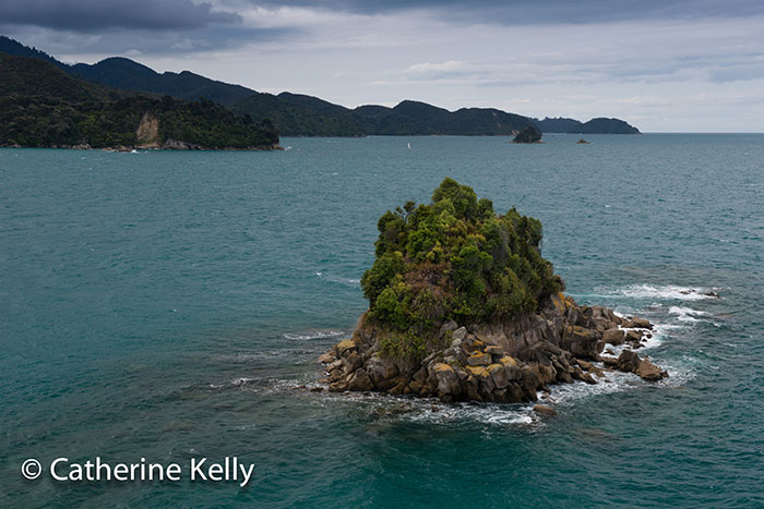 Rocky island at entrance to Anchorage Bay, Abel Tasman National Park, NZ