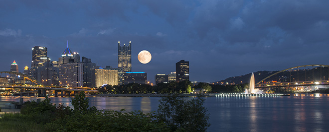 Artistic rendition of the moon rise with larger moon added in post processing.