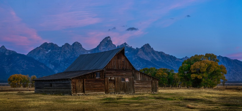 #mormon, #mormonbarn, #warmandcool, #yellowandblue, #foregroundandbackground, #grandtetons, #grandtetonnationalpark, #mountains, #sunrise, #dawn, #clouds, #iconic, #sony